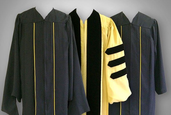 Three black and gold robes- 2 undergraduate, 1 doctoral.