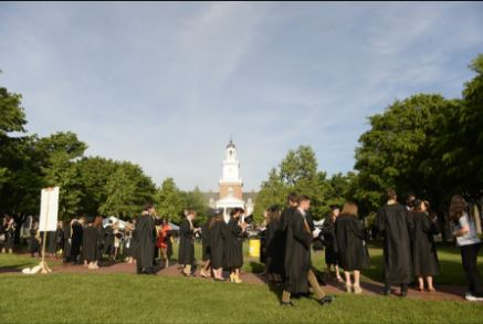 Graduates walking across campus.