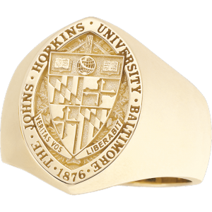 "Photo of gold class ring that reads ""The Johns Hopkins University Baltimore 1876,"" with the seal."