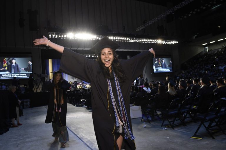 Photo of graduate celebrating