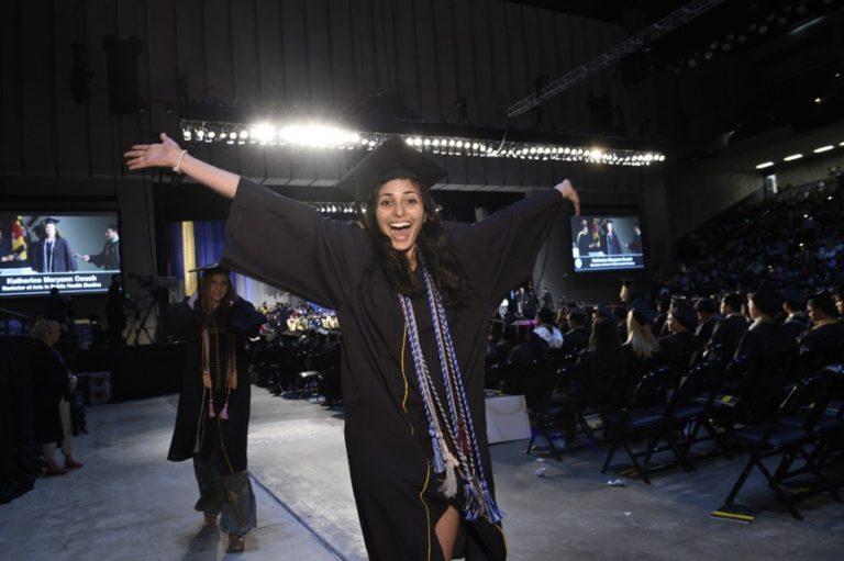 Photo of graduate celebrating