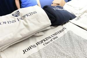 Photo of Johns Hopkins Class of 2016 clothing on display.