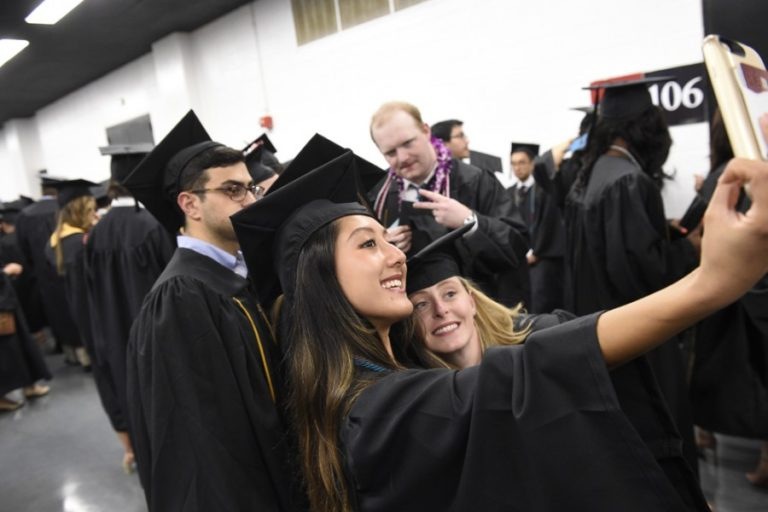 Photo of graduates taking a selfie